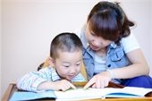 caregiver reading with child