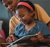child reading with mom